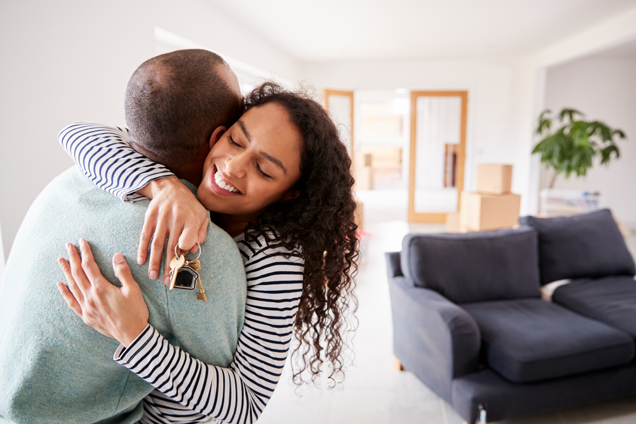 Loving couple moving home